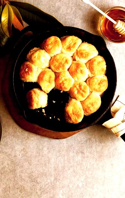 Welcome to Day Two of our Thanksgiving Countdown.We want to live inside this skillet full of Angel Biscuits.