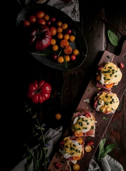 Eggs Benedict With Manchego, Tomatoes, Prosciutto & A Sage Hollandaise SauceSource